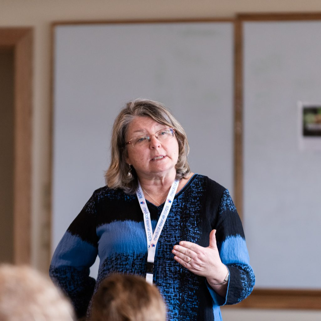 "Cindy Twombley, A Former Nurse With The Agency Of Human Services, Addresses The ""Helping And Healing"" Workshop."